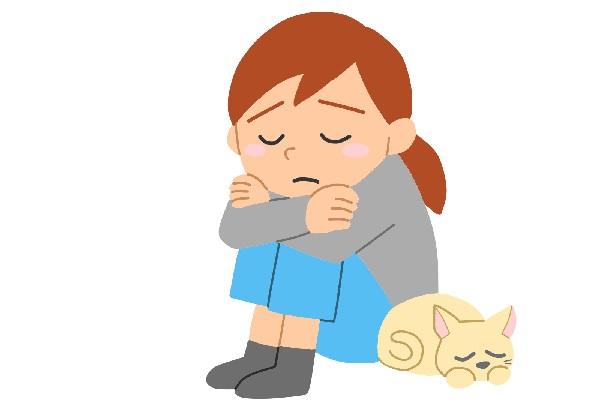 悲しんでいる女性とネコのイラスト